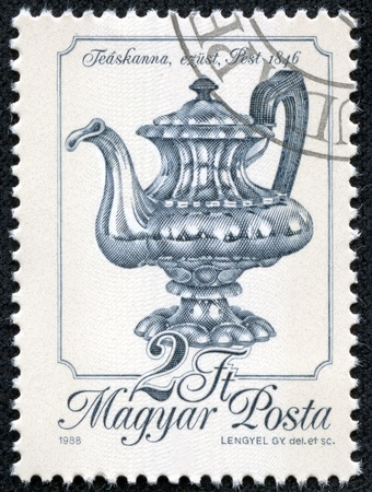 coining: HUNGARY - CIRCA 1988  A stamp printed in Hungary shows Silver Teapot, Pest, 1846, with the same inscription, from the series  Metal Work , circa 1988