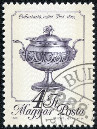 HUNGARY - CIRCA 1988  A stamp printed in Hungary shows Sugar bowl, Pest, 1822, with the same inscription, from the series  Metal Work , circa 1988