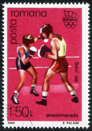 pre approval: ROMANIA - CIRCA 1988  A stamp printed in Romania, shows Olympic Rings and Boxing, with inscription and name of series  Pre-Olympic Games, Seoul 1988 , circa 1988