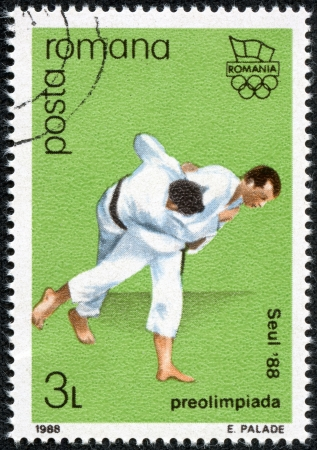 pre approval: ROMANIA - CIRCA 1988  A stamp printed in Romania, shows Olympic Rings and Judo, with inscription and name of series  Pre-Olympic Games, Seoul 1988 , circa 1988