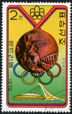 KOREA - CIRCA 1976  stamp printed in North Korea, shows Bronze Medal, emblem of Olympic Games, with inscription  Hockey, Pakistan , from series  Summer Olympic Games 1976, Medal Winners , circa 1976