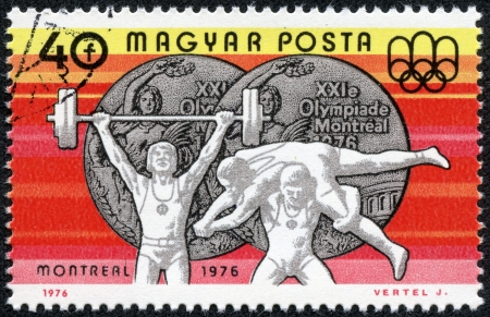 olympiad: HUNGARY - CIRCA 1976  A stamp printed in Hungary shows Weight Lifting and Wrestling, Silver medals, circa 1976 Editorial