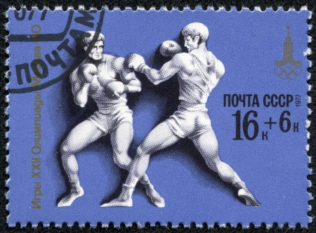 olympic ring: USSR - CIRCA 1980  A stamp printed in USSR, Olympic games Moscow 1980 Boxing, two boxers in ring, circa 1980 Editorial