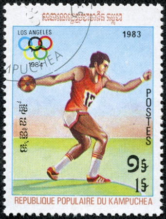 KAMPUCHEA-CIRCA 1983  A stamp printed in the Kampuchea, is dedicated to Summer Olympic Games in Los Angeles, Discus, circa 1983 Stock Photo - 19489213