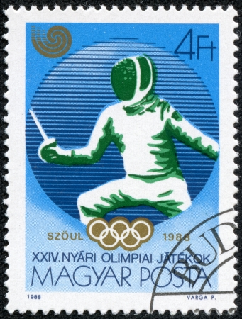 HUNGARY - CIRCA 1988  A stamp printed in Hungary, shows Fencing and Olympic emblem, with inscription and name of series  Olympic Games in Seoul, 1988 , circa 1988