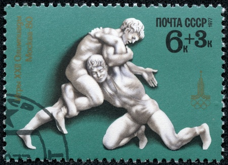 olympiad: USSR - CIRCA 1977  A stamp printed in USSR shows Free-style wrestling, with inscription and name of series  Games of XXII Olympiad, Moscow 1980 , circa 1977