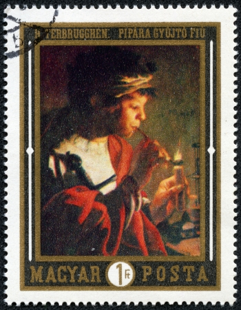 HUNGARY - CIRCA 1969  stamp printed by Hungary, shows boy lighting pipe, by Hendrick Terbrugghen, circa 1969