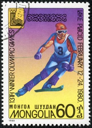 placid: MONGOLIA - CIRCA 1980 stamp printed by Mongolia, shows Lake Placid 80 Emblem, Downhill skiing, circa 1980 Editorial