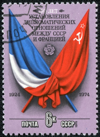 USSR - CIRCA 1975  stamp printed in USSR, shows Flags and Arms of France and USSR, Factories, circa 1975  photo
