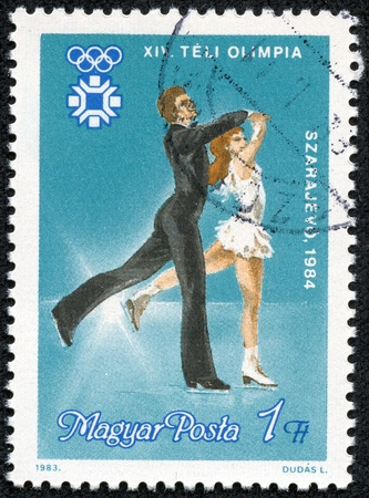 HUNGARY - CIRCA 1983  a stamp printed in the Hungary shows Ice Dancers, 1984 Winter Olympics, Sarajevo, circa 1983
