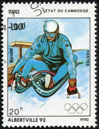 olympic sports: CAMBODIA - CIRCA 1990  A post stamp printed in Cambodge shows sportsman and devoted the winter olympic games in Alberville, series, circa 1990 Editorial