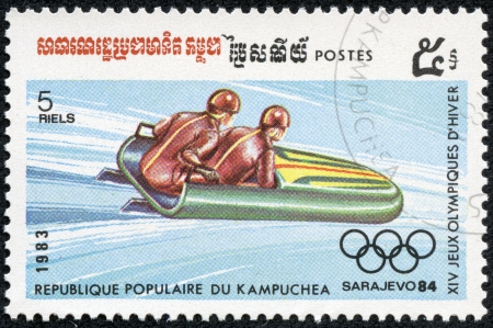 bobsled: CAMBODIA - CIRCA 1983  A stamp printed in Kampuchea, shows a bobsled and the Olympic Games emblem, circa 1983