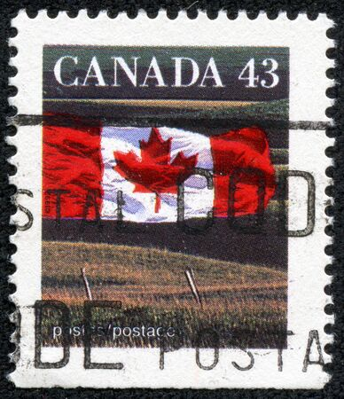 CANADA - CIRCA 1991  A stamp printed in Canada shows Canadian flag and Prairie, without the inscriptions, from the series  Canadian flag , circa 1991