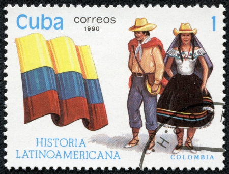 american history: CUBA - CIRCA 1990  A stamp printed in Cuba, shows Flag and a couple dressed in national costumes from Colombia, with inscription and name of series  Latin American history , circa 1990  Stock Photo