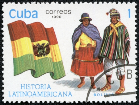 american history: CUBA - CIRCA 1990  A stamp printed in Cuba, shows Flag and a couple dressed in national costumes from Bolivia, with inscription and name of series  Latin American history , circa 1990
