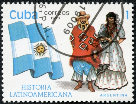 american history: CUBA - CIRCA 1990  A stamp printed in Cuba, shows Flag and a couple dressed in national costumes from Argentina, with inscription and name of series  Latin American history , circa 1990