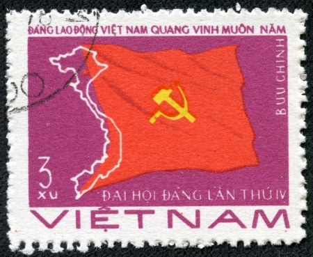 VIETNAM - CIRCA 1976  A stamp printed in Viet Nam showing flag with sickle and hammer,devoted to the Viet Nam Worker s Party, 4th Natl Congress, circa 1976