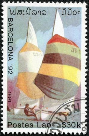 summer olympics: LAOS-CIRCA 1991  A stamp printed in the Laos, is devoted to the Summer Olympics in Barcelona, sailing, circa 1991