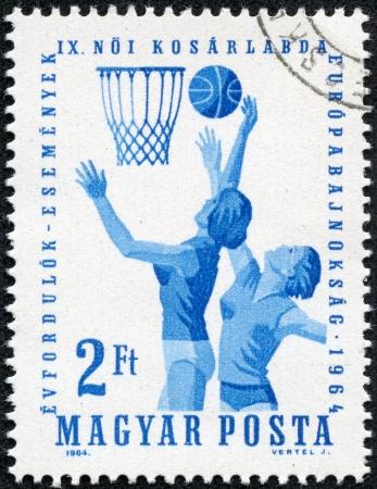 magyar posta: HUNGARY - CIRCA 1964  A stamp printed in Hungary shows image of netball players, series, circa 1964 Stock Photo