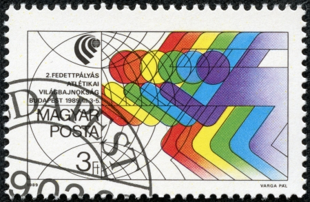 furtherance: HUNGARY- CIRCA 1989  stamp printed by Hungary, shows the emblem of world indoor sports championsip in Budapest, circa 1989