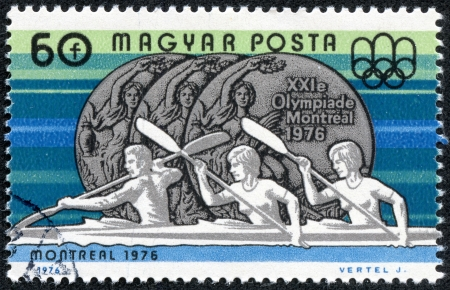 magyar posta: HUNGARY - CIRCA 1976  A stamp printed in Hungary shows Rowing and Olympic medal with the inscription  Montreal,1976  , from the series  Olympic Games in Montreal, 1976 , circa 1976