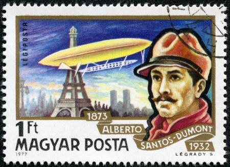 magyar: HUNGARY - CIRCA 1977  A Stamp printed in HUNGARY shows a Brazilian aviation pioneer Alberto Santos-Dumont and his dirigible over Eiffel Tower in Paris, circa 1977 Editorial