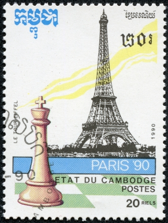 CAMBODIA - CIRCA 1990  stamp printed by Cambodia, shows Chess piece and Eiffel Tower, circa 1990 Stock Photo - 20289385