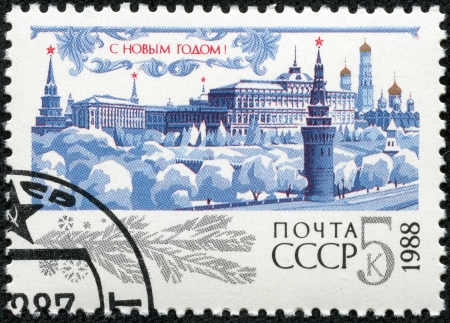 USSR - CIRCA 1987  A cancelled stamp printed in the USSR, shows Kremlin with red star, trees under snow for New Year, circa 1987  Happy New Year 1988 as text