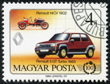 magyar: HUNGARY - CIRCA 1986  Hungarian commemorative stamp celebrating 100 years of the automobile  Renault 14CV and Renault 5 GT Turbo  circa 1986