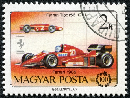 HUNGARY - CIRCA 1986  A stamp printed in Hungary shows Ferrari 1985 and ferrari tipo 156 1961, circa 1986 Stok Fotoğraf