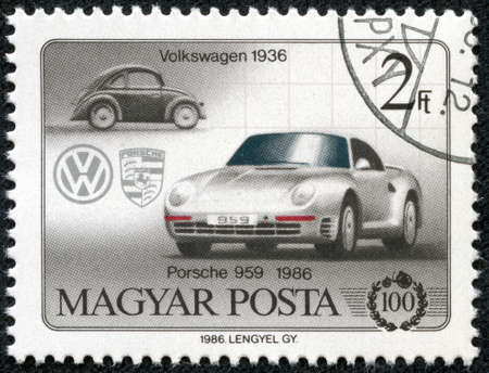 volkswagen: HUNGARY - CIRCA 1986  A stamp printed in Hungary shows Volkswagen 1936 and Porsche 959, circa 1986