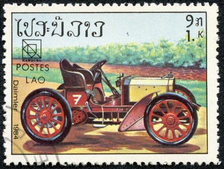 daimler: LAOS - CIRCA 1984  mail stamp printed in Laos featuring a vintage Daimler sports car, circa 1984