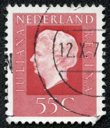 NETHERLANDS - CIRCA 1969  A stamp printed in Netherlands shows portrait of Queen regnant of Netherlands Juliana with the inscription  Juliana regina , from the series  Queen Juliana , circa 1969 photo