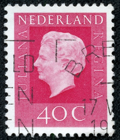 regnant: HOLLAND - CIRCA 1970  Stamp printed in the Netherlands shows the queen  Juliana , circa 1970 Stock Photo