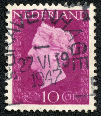 regnant: NETHERLANDS - CIRCA 1947  A stamp printed in Netherlands shows portrait of Queen Wilhelmina - Queen regnant of Netherlands Kingdom  1890 - 1948 , w o inscription, series  Queen Wilhelmina , circa 1947