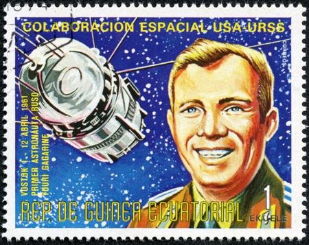 gagarin: EQUATORIAL GUINEA - CIRCA 1974  A stamp printed in Guinea shows Vostok1 and Yuri Gagarin, Apollo-Soyuz Space Project, circa 1974