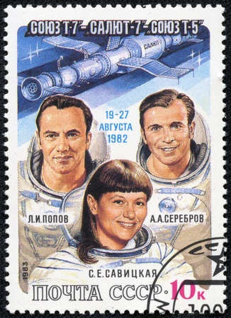 t5: USSR - CIRCA 1983  A post stamp printed in USSR  Russia , shows astronauts Popov, Serebrov and Savitskaya with inscriptions and name of series  Soyuz T-7, Salyut 7, Soyuz T-5 Space Flight , circa 1983 Editorial