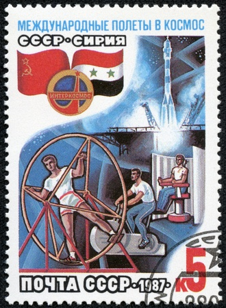 USSR - CIRCA 1987  A post stamp printed in USSR divided to international Soviet Syrian space flights, circa 1987