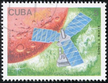 USSR - CIRCA 1988  The postal stamp printed in USSR is shown by the sputnik on a green hum about a red planet, CIRCA 1988