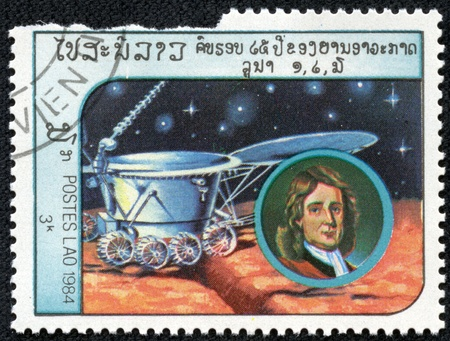 isaac newton: LAOS-CIRCA 1984  A stamp printed in the Laos, depicts the spacecraft Lunokhod-2 and a portrait of Isaac Newton, circa 1984