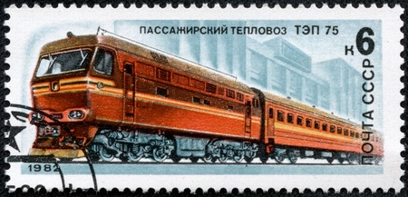 USSR - CIRCA 1982  A stamp printed in USSR shows a red train for passengers on a rails, circa 1982