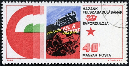 build up: HUNGARY - CIRCA 1975  A stamp printed by Hungary, shows Poster  Let us Build up the Railroads , circa 1975
