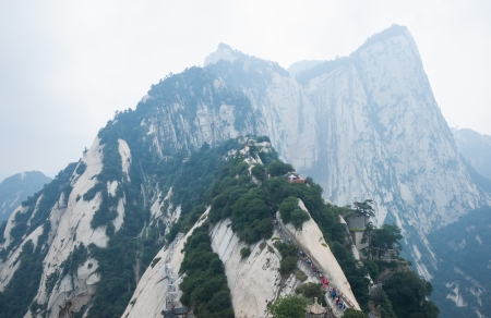 Mount Hua,located in Shaanxi,is the highest of China's five sacred mountains, called the  West Mountain ,well known for steep trails, breath-taking cliffs, narrow passages, and grand scenery