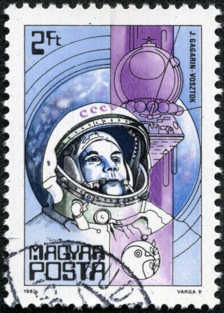 HUNGARY - CIRCA 1982  A Stamp printed in Hungary shows Yuri Gagarin  first man in space  and Vostok, with the same inscription, from the series  Space Research , circa 1982