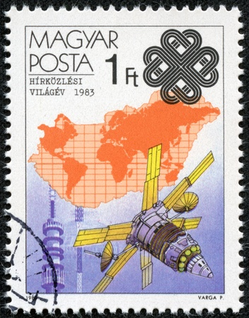 magyar posta: HUNGARY - CIRCA 1983  A Stamp printed in Hungary shows Molnya Satellite and Kekes TV Tower, with inscription and name of series  World Communications Year , circa 1983