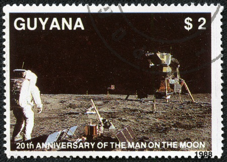 GUYANA - CIRCA 1988  a stamp from Guyana shows image of the first moon landing, circa 1988 報道画像