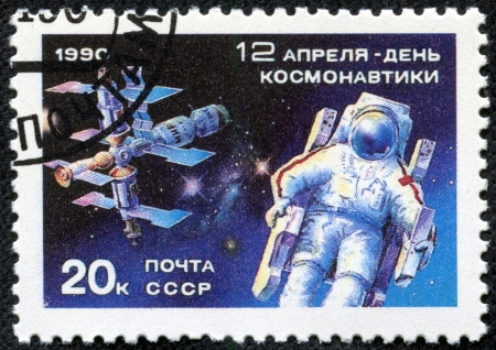 maneuvering: USSR - CIRCA 1990  A stamp printed in the USSR, shows a cosmonaut in a maneuvering unit outside the Mir Space Station, circa 1990