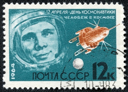 yuri: USSR - CIRCA 1964  A retro post stamp, printed in USSR and devoted the first man s flight , shows the portrait of astronaut Gagarin  Circa 1964