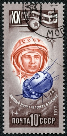 space age: RUSSIA - CIRCA 1977  Stamp printed in USSR  Russia , shows astronaut Jury Gagarin, with inscription and name of series  20 years of a space age , circa 1977