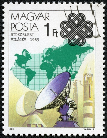 magyar posta: HUNGARY - CIRCA 1983  A Stamp printed in Hungary shows Dish aerials and rocket, with inscription and name of series  World Communications Year , circa 1983